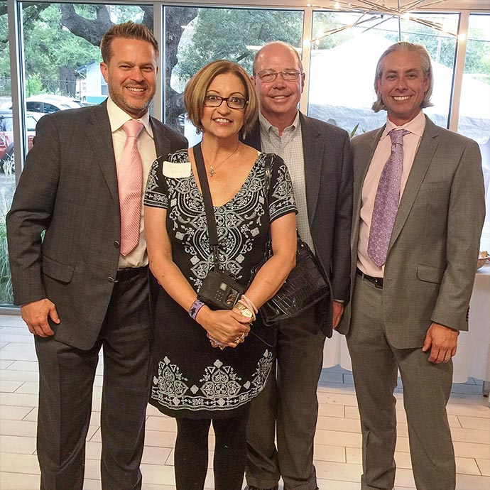 Dr. Robert Whitfield, Dr. Jack Walzel, and Dr. Ned Snyder with Breast Reconstruction patient at BRA Day