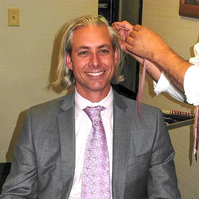 Dr. Ned Snyder getting a pink hair extension for his patients at BRA Day